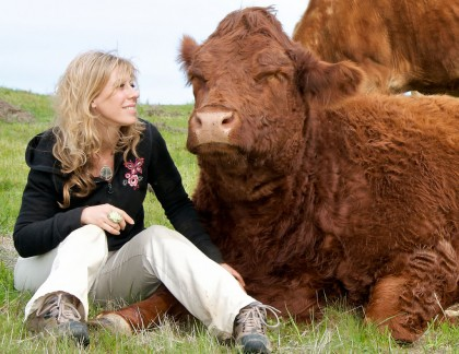Colleen Patrick-Goudreau with cow.jpg